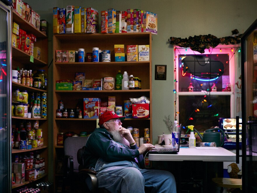 """Gary Carr works at the Kozy Korner grocery store. """"He spends a lot of time on that computer,"""" photographer Reed Young says. """"One of his obsessions was keeping up with Top 40 radio."""""""