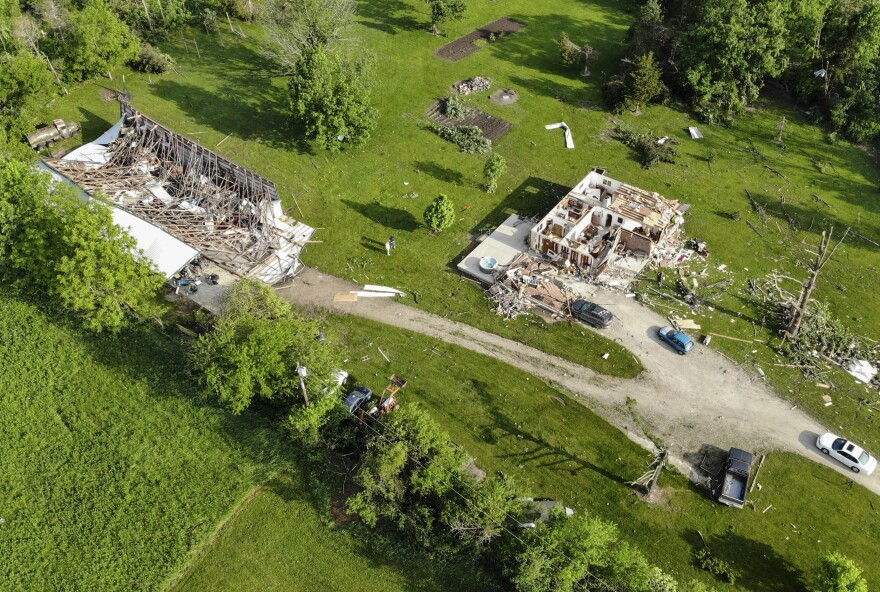Storm-damaged homes after a tornado passed through the area the previous evening in Brookville, Ohio.