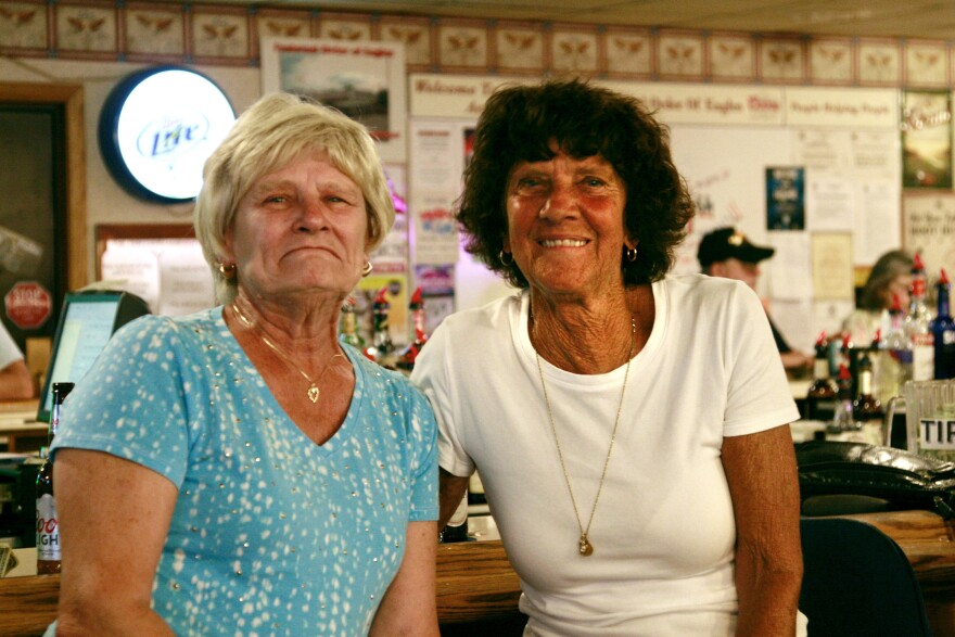 "Elaine Latuch (left) and Mary Denning enjoy burger night at the Fraternal Order of Eagles in Somerset County, Pa. The county, Latuch says, offers ""nothing"" for younger people, so they leave."