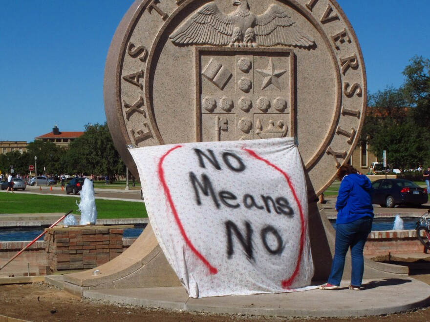 "Texas Tech freshman Regan Elder helps drape a bed sheet with the message ""No Means No"" over the university's seal at the Lubbock, Texas campus in 2014 to protest what students say is a ""rape culture"" on campus."