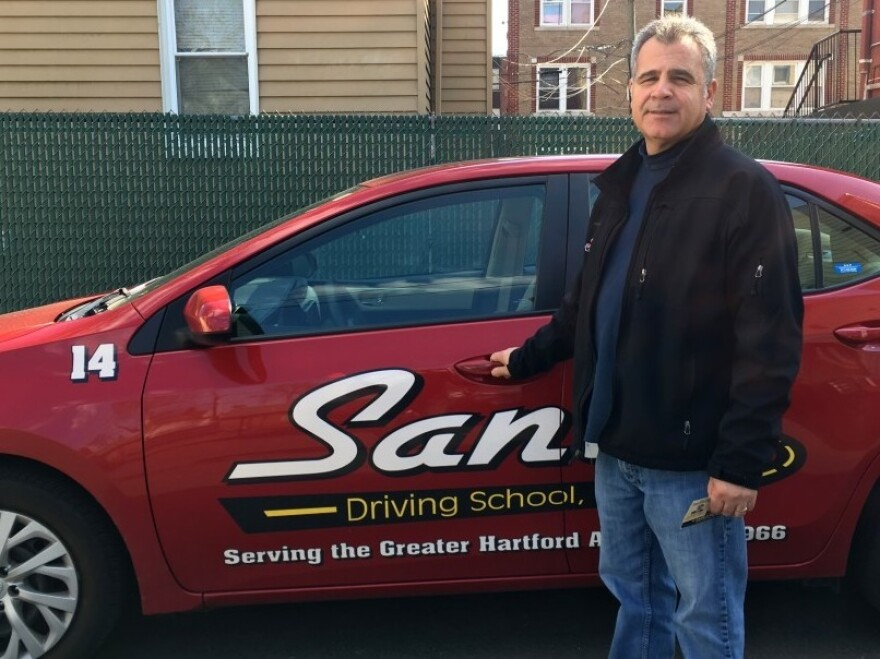 Sal Calafiore, owner of Santo Driving School in Hartford, Conn., saw a surge of business after Connecticut implemented its Drive Only licensing program, allowing more than 50,000 undocumented immigrants to get trained and licensed.