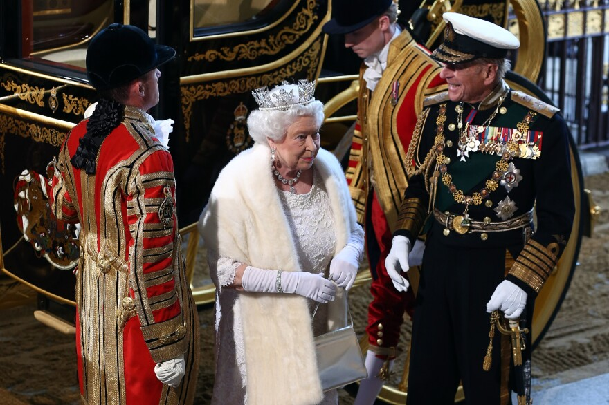 Queen Elizabeth II, accompanied by her husband, Prince Philip, Duke of Edinburgh, arrives for the opening of Britain's Parliament in May.