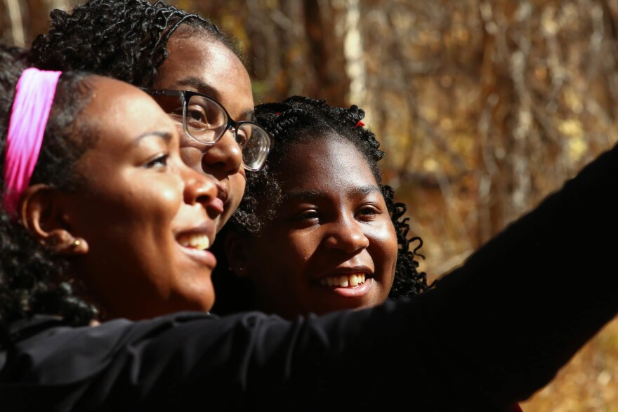(Left to right) Jessica Newton, her 16-year-old cousin Jewyl Newton, and her 14-year-old daughter Joy Eloi, pause to take a selfie mid-hike.
