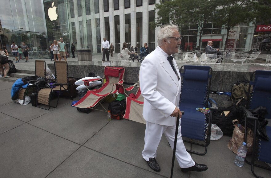 Among Apple fans, anticipation has been building over the company's possible release of a smart watch Tuesday. In Manhattan, a man dressed as Colonel Sanders was among those who gathered at an Apple Store ahead of today's event.