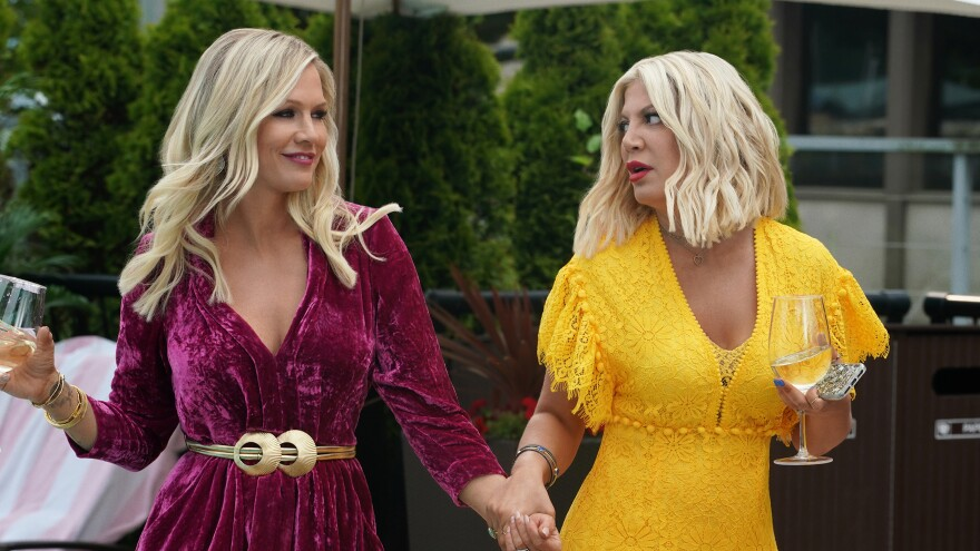 Jennie Garth and Tori Spelling play themselves in <em>BH90210</em>, which both is and isn't a <em>Beverly Hills, 90210 </em>reboot. It's complicated.