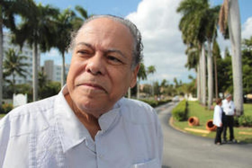 """""""I'm the other half of Cubans not out celebrating:""""  Gorki Carrillo, whose family fled the Castro regime in 1960, calls for more """"reflection"""" on the part of the Cuban exile community, and says trade """"obligating Cuba to deal with the world"""" is the best way to foster political change."""