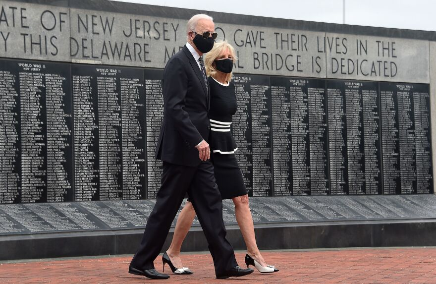 Joe Biden and his wife, Jill Biden, wear masks as they mark Memorial Day. The president-elect has consistently worn masks amid the pandemic, and he's already talking to governors about trying to implement a national mask mandate.
