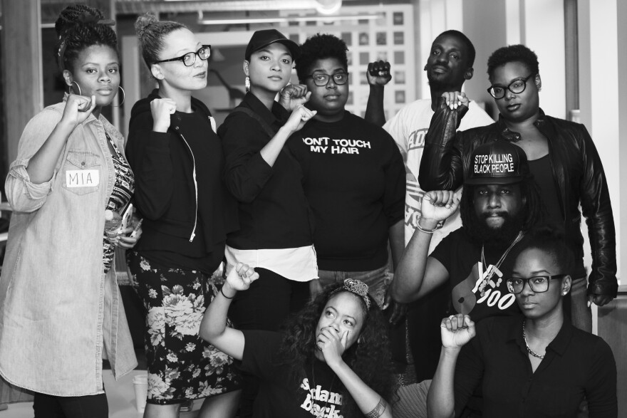 Participants in St. Louis' Black & Engaged trainings pose with fists raised after part of the weekend's sessions.