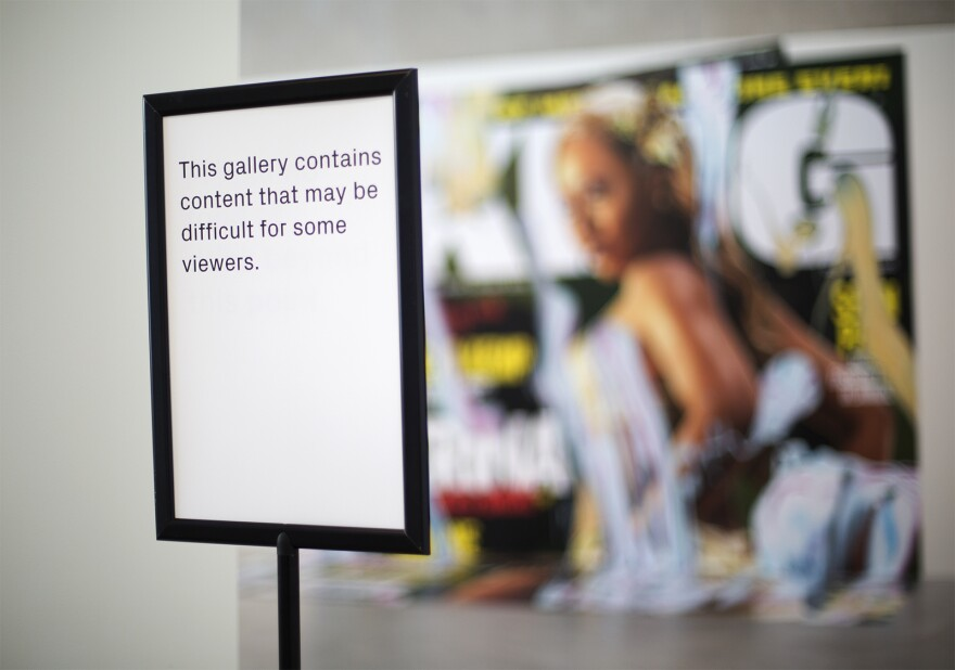 Visitors to the Contemporary Art Museum are now (Sept. 30, 2016) greeted by warning signs and a wall that went up in front of Kelley Walker's Direct Drive exhibit following criticism and outrage of the work.