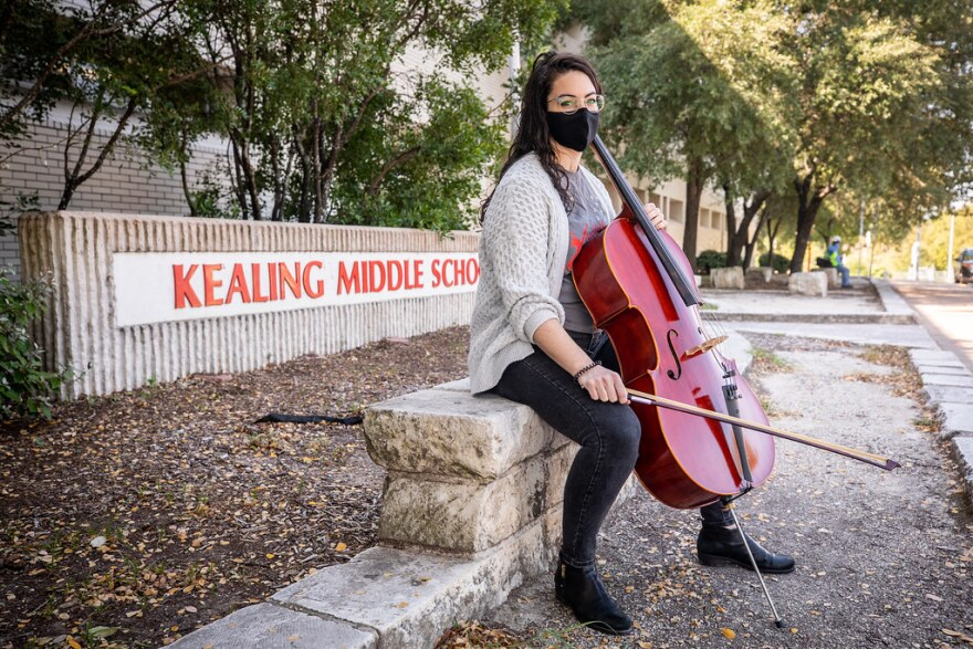 Madeline Horrell poses outside Kealing Middle School with her cello.