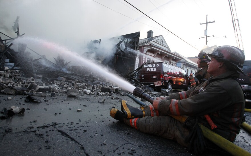 Firefighters work to put out the fire at Hubig's Pies in New Orleans on July 27, 2012.