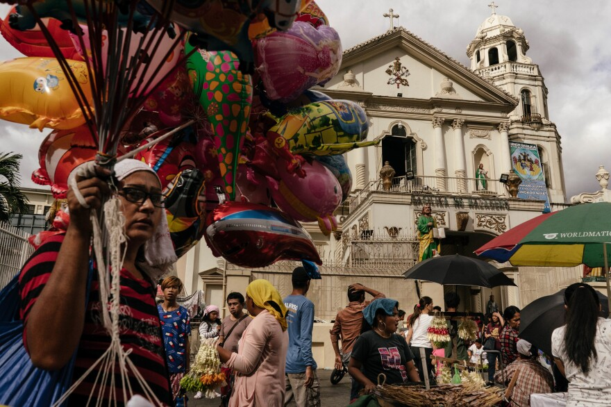 Vendors outside the Quiapo Church in Manila. Some sell herbs, roots and bottled pills used to induce abortion — which is illegal in all circumstances in the majority Catholic country.