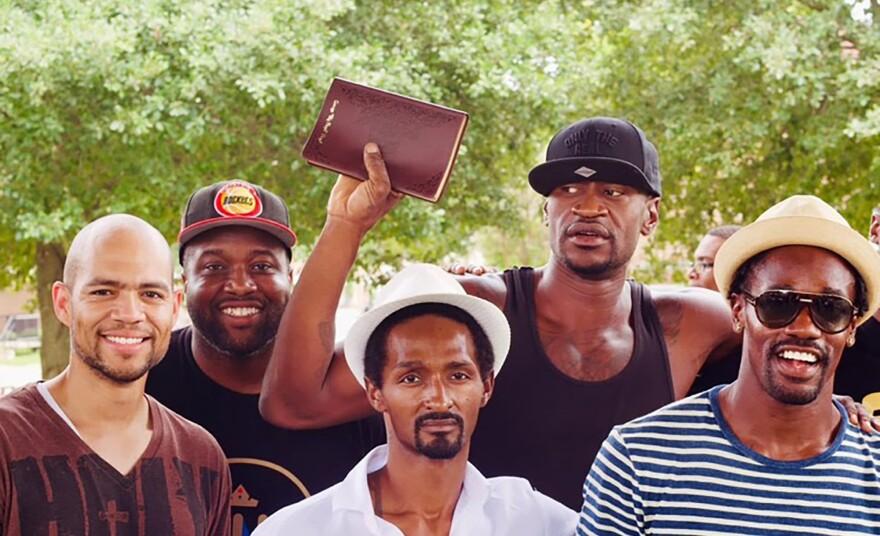 George Floyd holds up a Bible. (Resurrection Houston/Nijalon Dunn)