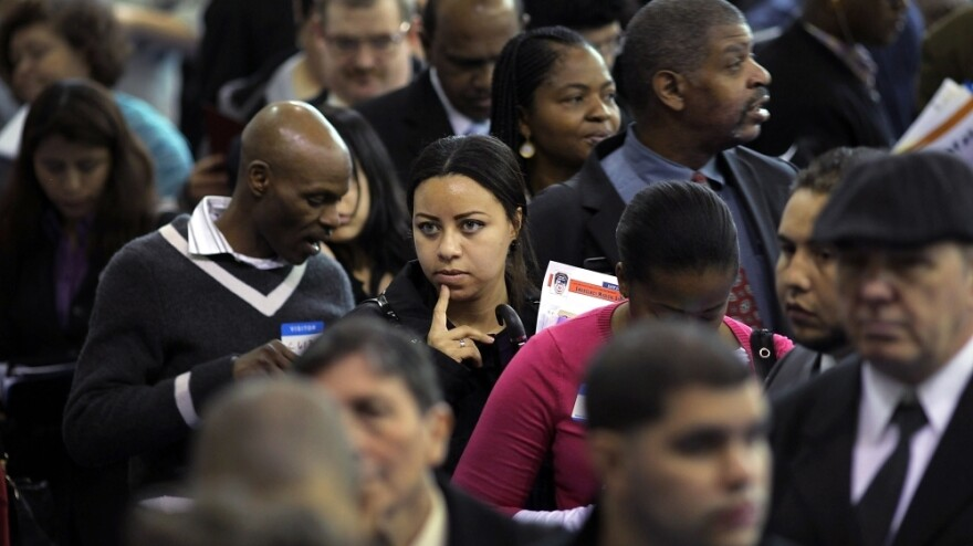 People wait at a job fair in New York City's Queens borough on Thursday. While millions of out-of-work Americans continue to seek employment, others have given up looking.