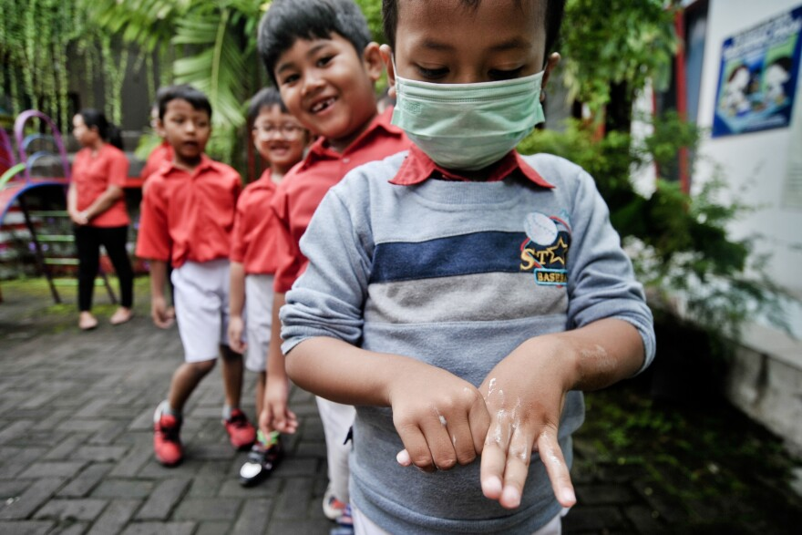 On March 4, kindergartners in Sleman, Indonesia, attend a hand-washing training session.
