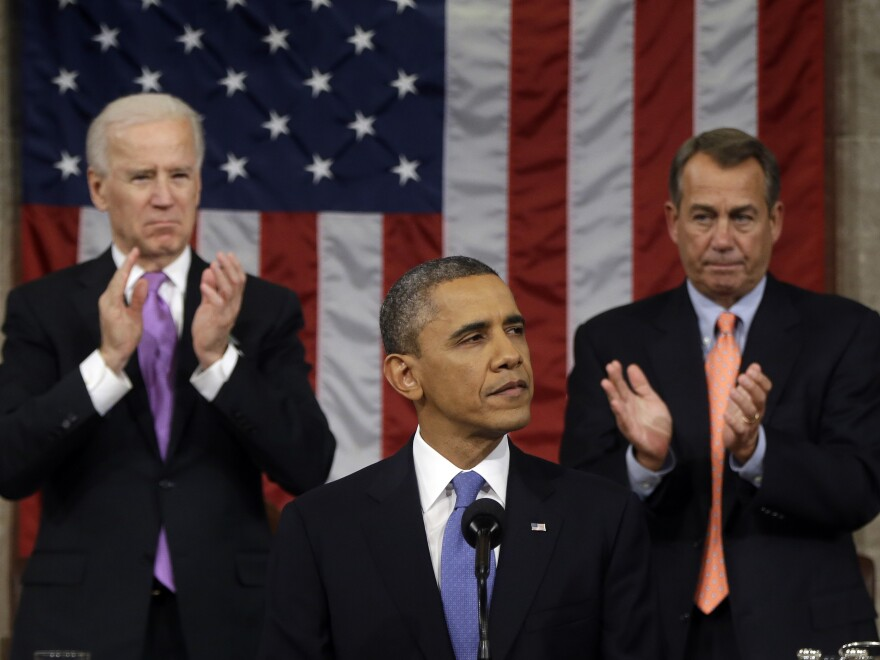 Vice President Biden and House Speaker John Boehner of Ohio applaud President Obama as he gives his State of the Union address during a joint session of Congress on Feb. 12, 2013.