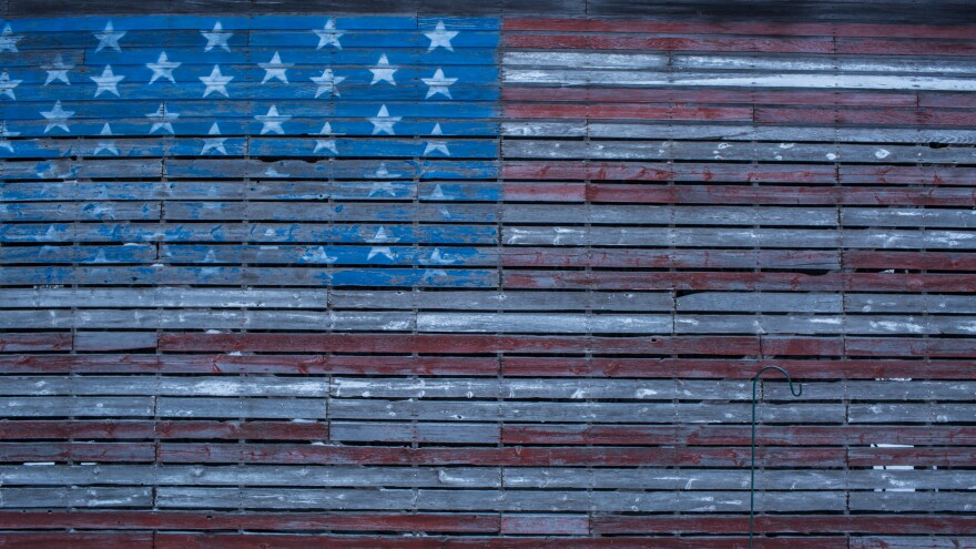 An American flag is painted on the side of a barn outside Webster City, Iowa.