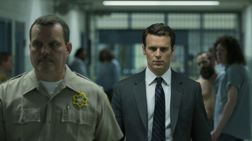 Jonathan Groff plays a young FBI agent with bold new ideas about how to learn from imprisoned murderers in the Netflix series <em>Mindhunter,</em> which becomes available on Friday.
