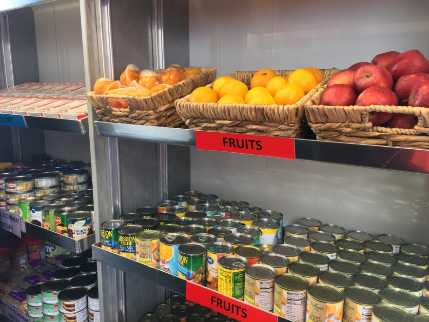 Fruits and canned foods are some of the items on display inside one of Charlotte's new mobile food pantries.