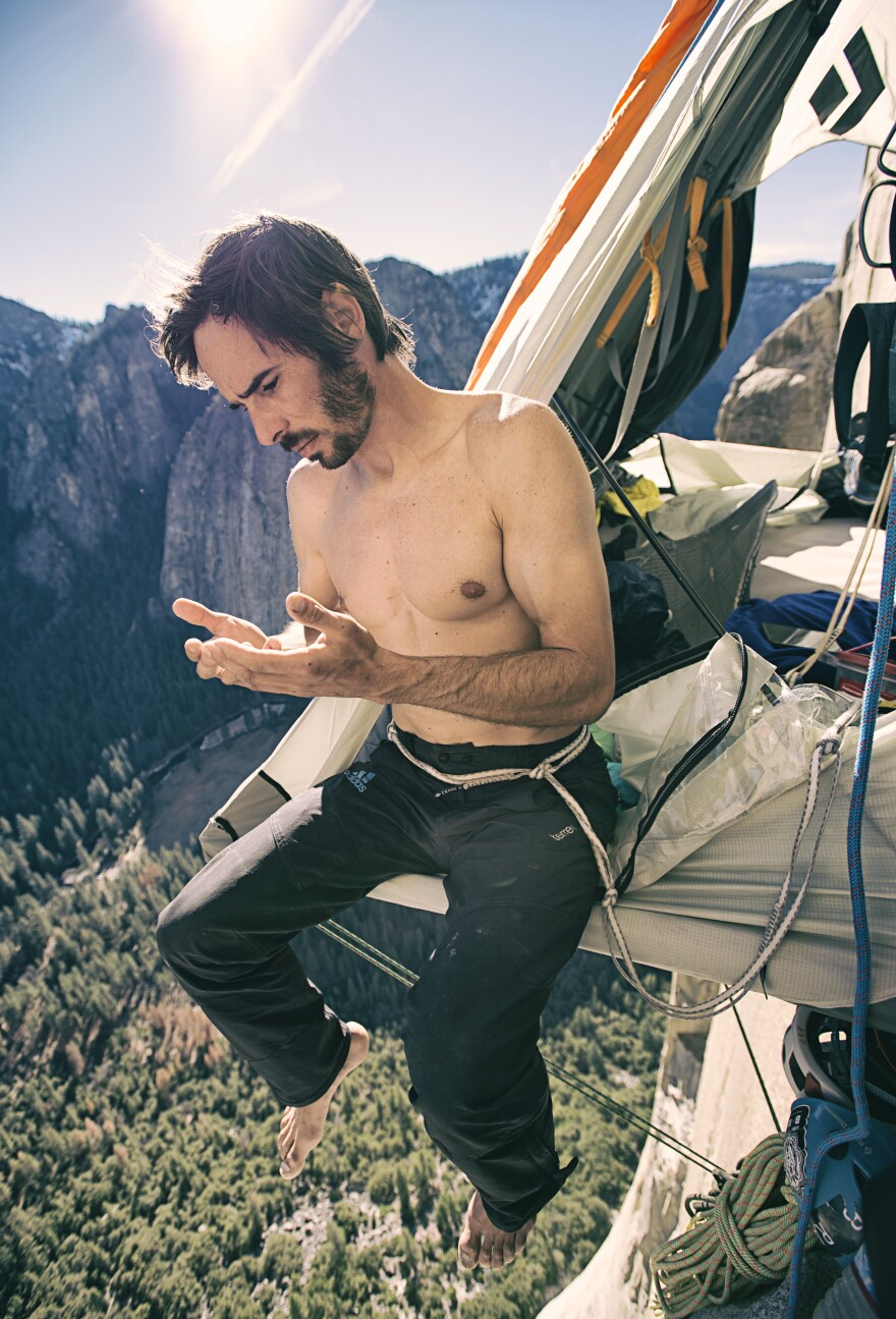 Jorgeson checks to see how much skin has grown back after a night of rest in his portaledge.