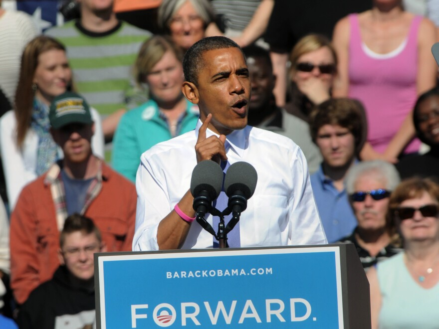 """During a campaign speech at Veterans Memorial Park in Manchester, N.H., Oct. 18, President Obama once again embraced the term """"Obamacare"""" while discussing the Affordable Care Act."""