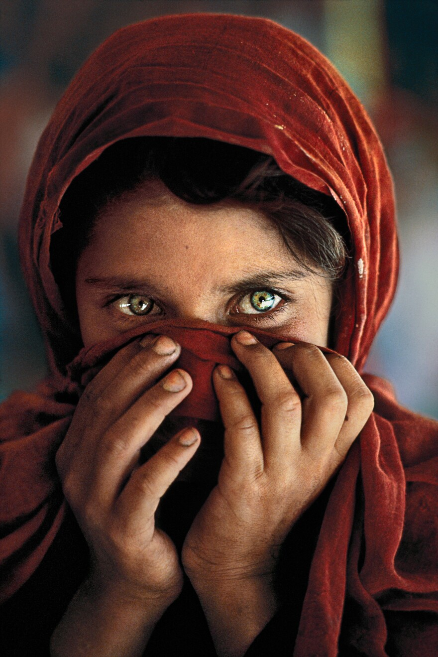 When McCurry started taking Gula's photo, she put her hands up to cover her face. But her teacher asked her to put her hands down so the world would see her face and know her story.