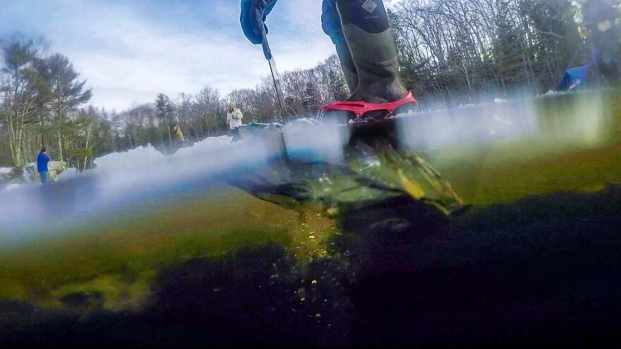 Cutting through the ice on Thompson pond