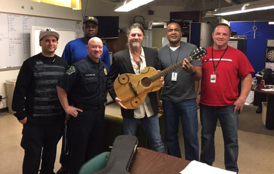 Austin Police Chief Art Acevedo tweeted this picture of police posing with Wilkins and his newly-returned guitar.