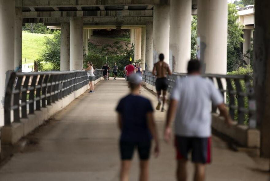 Pedestrians on the Ann and Roy Butler Hike-and-Bike Trail in Austin on June 24.