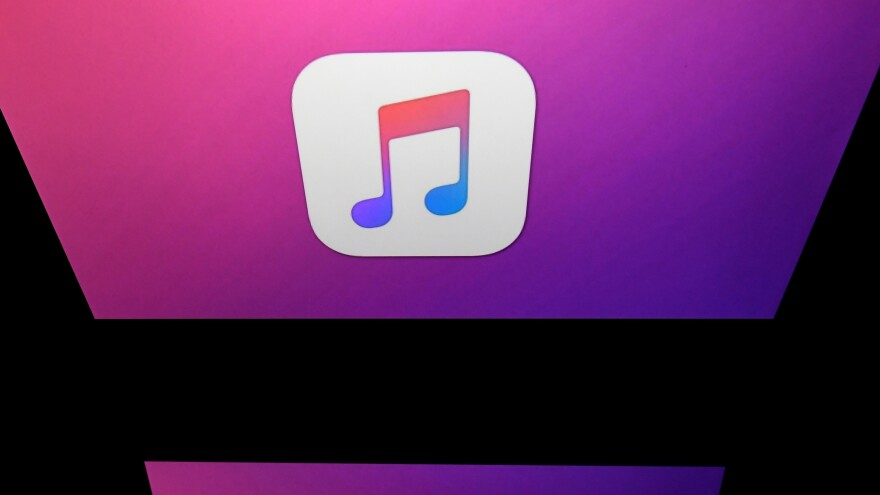 This illustration taken in April 2018 shows the logo of the iTunes app of Apple displayed on a tablet screen in Paris.