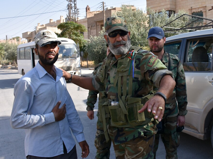 Syrian Brig. Gen. Issam Zahreddine (right) speaks with a civilian in the eastern city of Deir Ezzor in September, during the offensive against ISIS militants.