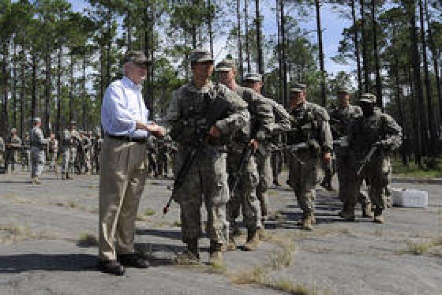 Defense Secretary Robert M. Gates shakes hands with Army Ranger trainees at the Ranger Training Area on Eglin Air Force Base in Florida.