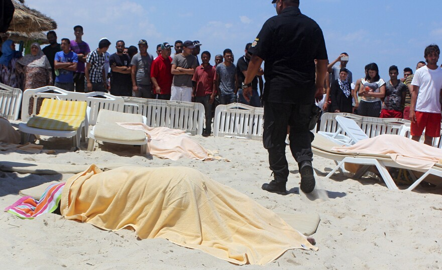 The body of a tourist lies near a beachside hotel in Sousse, Tunisia. Dozens of people were killed Friday when at least one gunman opened fire at the hotel, an interior ministry spokesman said.