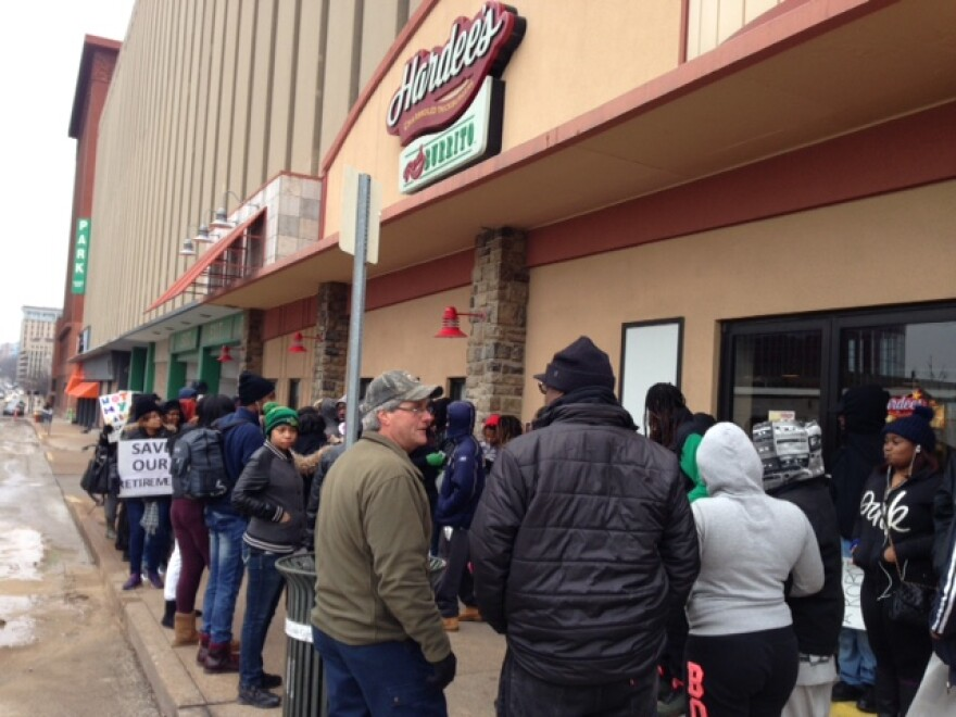 Protesters gathered outside a downtown St. Louis Hardees on Thursday in opposition to Donald Trump's selection for Labor Secretary