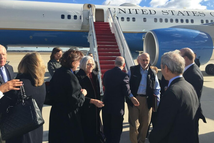 Alan Gross (third from right) disembarks with his wife, Judy (fourth from left), from a U.S. government plane at Joint Base Andrews in Maryland.