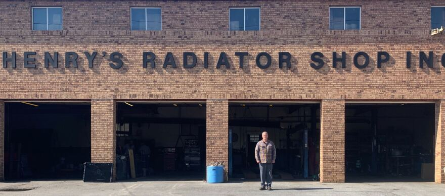 Henry Hornsby Jr. stands in front of his family business, Henry's Radiator Shop.