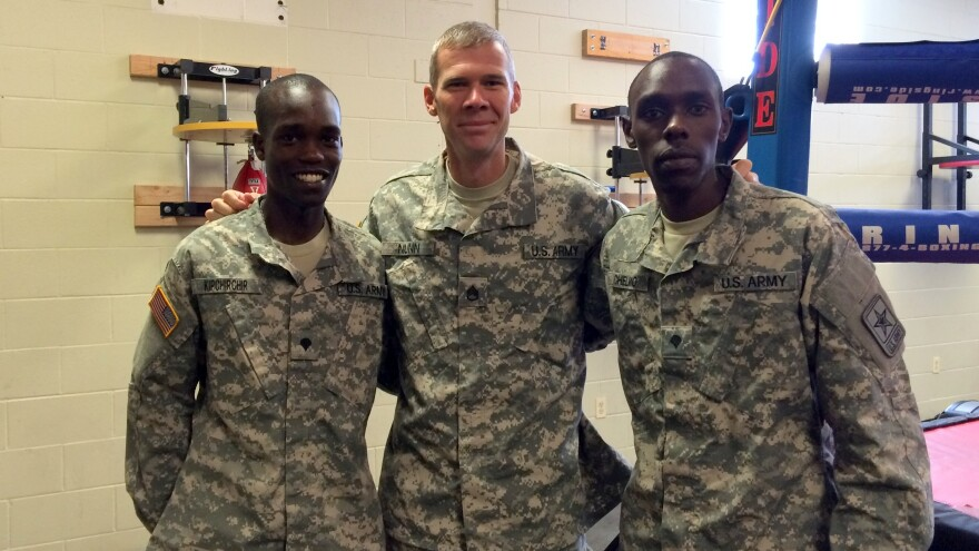 U.S. Army soldiers who qualified for the U.S. Olympic track team include, from left, Spc. Shadrack Kipchirchir in the 10,000 meters, Staff Sgt. John Nunn in the 50k race walk, and Spc. Paul Chelimo in the 5,000 meters. The trio, photographed in Fort Carson, Colo., are among 11 soldiers going to Rio.