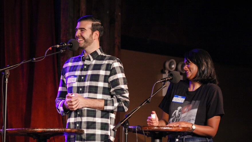 Contestants Dan Fleishaker and Radhika Nataraj face off in a game on <em>Ask Me Another</em> at the Bell House in Brooklyn, New York.