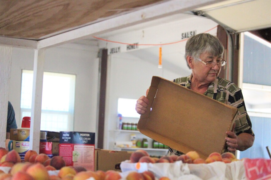 Randy Pehl runs Behrend's Orchard Peaches. She is worried about the health and safety of her staff, most of whom are family, but also about the viability of her business if visitation declines significantly.