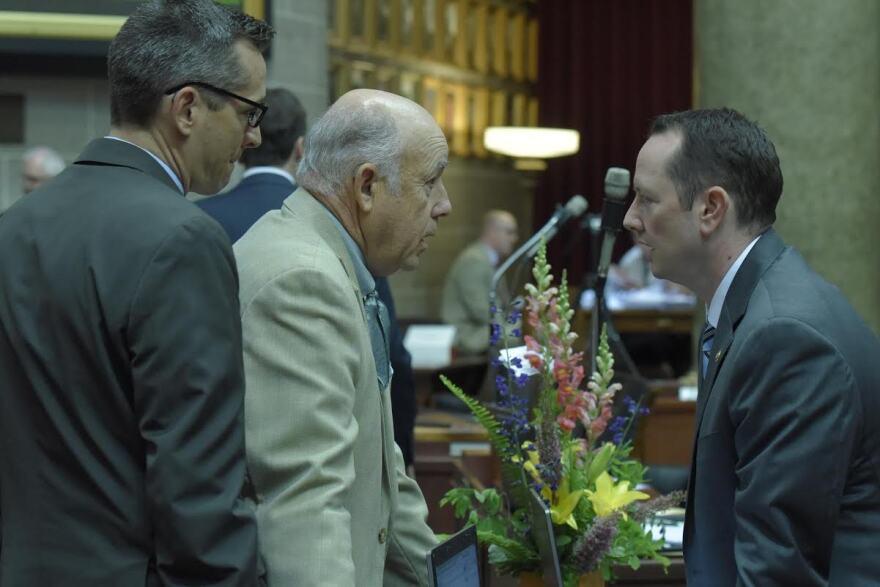 Rep. Warren Love (center) speaks with Rep. Eric Burlison (right) during the 2016 legislative session.