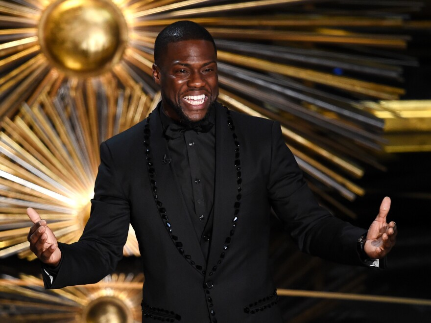 Actor and comedian Kevin Hart speaks onstage at the Academy Awards in 2016. Hart was slated to host the 2019 Oscars but withdrew after he was criticized for controversial jokes he made in 2010