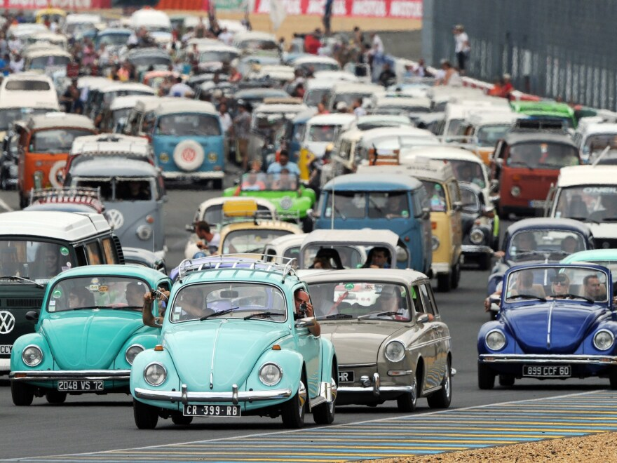 The Volkswagen Beetle will cease production on Wednesday at the company's factory in Puebla, Mexico. Here, vintage Beetles and other Volkswagen models at a VW festival in France in 2014.