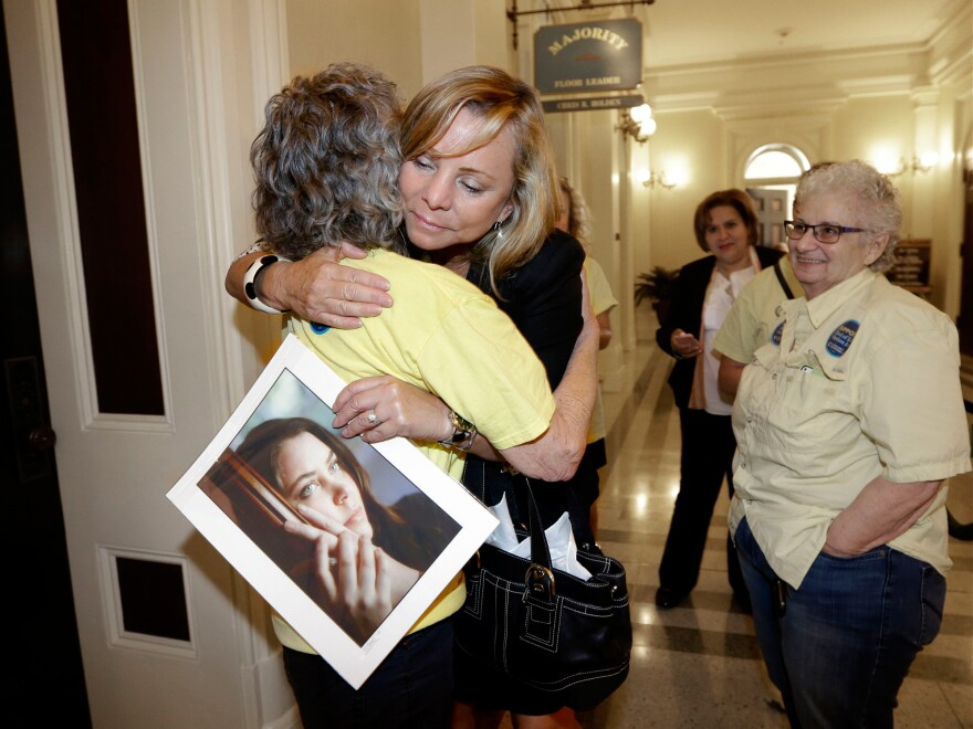 Debbie Ziegler holds a photo of her late daughter, Brittany Maynard, after the California State Assembly approved a right-to-die measure on Sept. 9. Maynard died on Nov. 1, 2014.