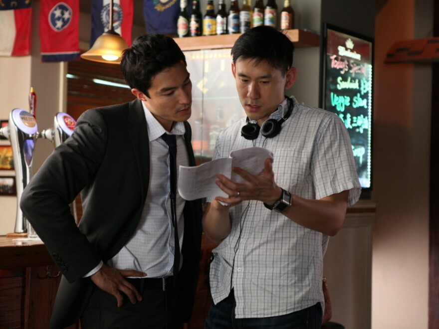 Director Daniel Hsia (right) talks with Henney on the set of <em>Shanghai Calling</em>.