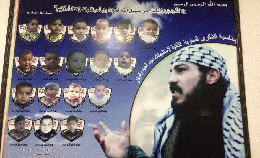 A poster of Baha Abu Jarad, a member of the Fatah movement, who was killed by the rival Hamas faction, according to his family. The small photos show children that were named after Baha.