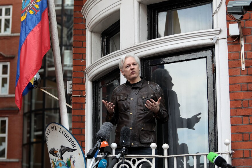 Julian Assange speaks to the media from the balcony of the Embassy Of Ecuador in London in 2017. The founder of the WikiLeaks website was forcibly removed from the embassy earlier this year and is fighting extradition to the U.S. to face charges related to the Manning leaks.