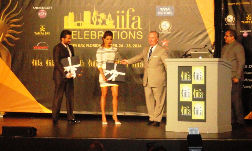 Tampa Mayor Bob Buckhorn greets Anil Kapoor, left, and Priyanka Chopra