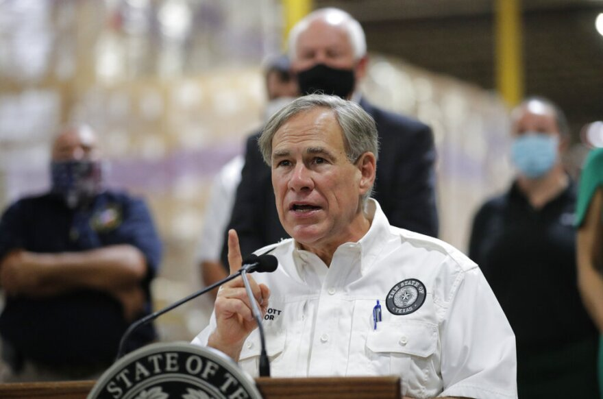 Gov. Greg Abbott speaks to the media during a visit to a Texas Division of Emergency Management Warehouse on Aug. 4.