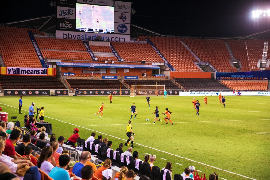Fans watch the match from the lower-level of a nearly empty stadium in Houston.