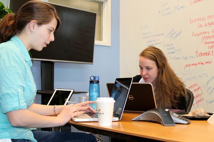 Michelle Fiats (left) and Dana Watts work on their startup idea.